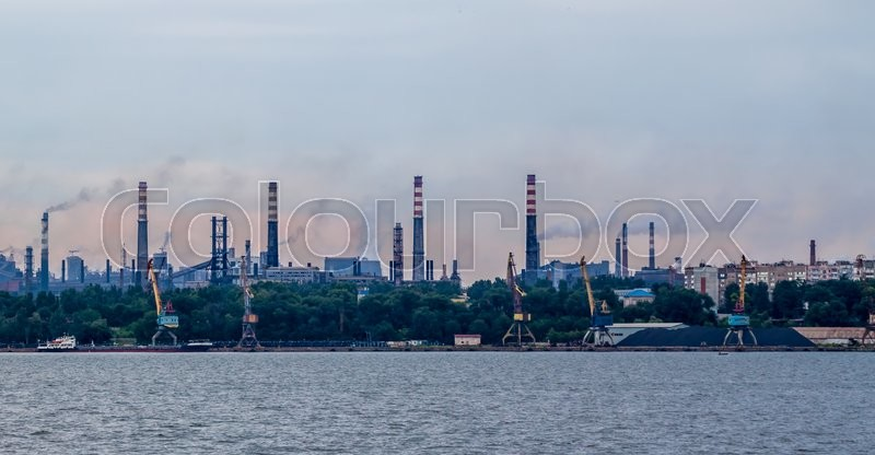 Stock image of 'industrial landscape with factory  pipes and smoke going out'