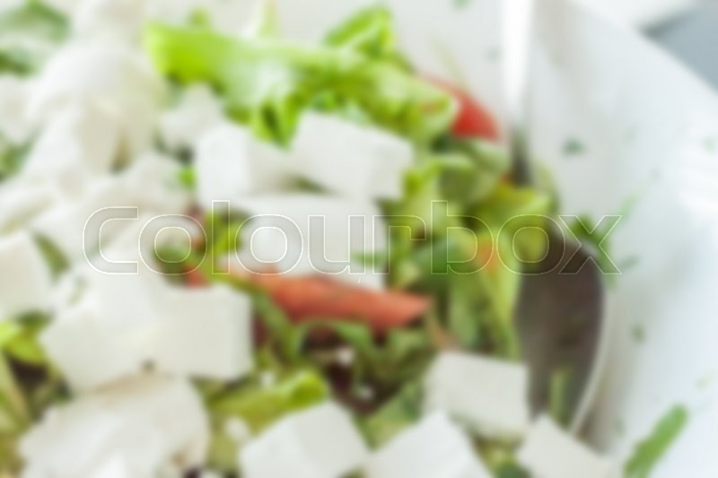 Stock image of 'blurred fresh spring salad can be used as background'