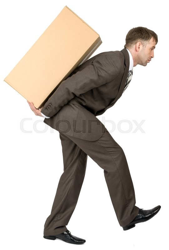 Stock image of 'Young man in suit carrying cardboard box on his back. Isolated'
