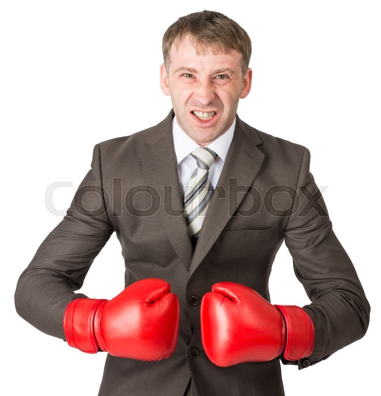 Stock image of 'Angry businessman in boxing gloves isolated on white background'