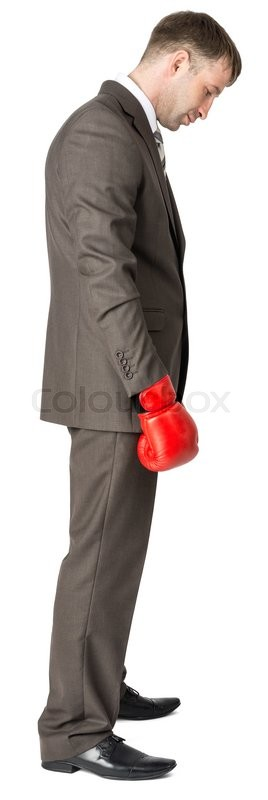 Stock image of 'Sad businessman in boxing gloves isolated on white background'