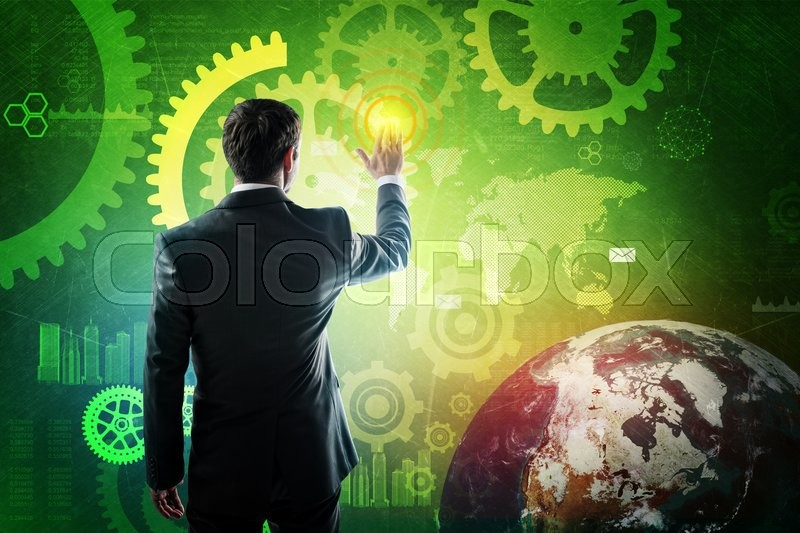 Stock image of 'Businessman in suit pressing virtual button on screen. Elements of this image furnished by NASA'