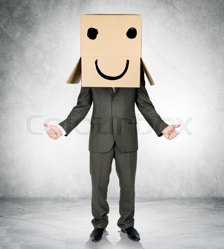 Stock image of 'Businessman gesturing with box on head and smiley face'