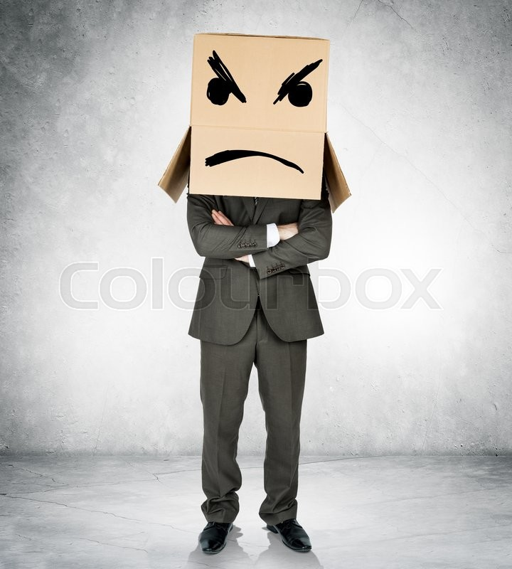Stock image of 'Depressed man with box over head with crossed arms'