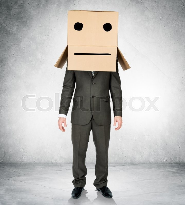 Stock image of 'Businessman wearing carton box with drawn emotions on head'
