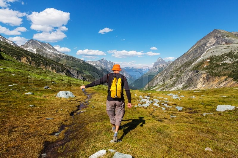 Stock image of 'Hiking man in the mountains'