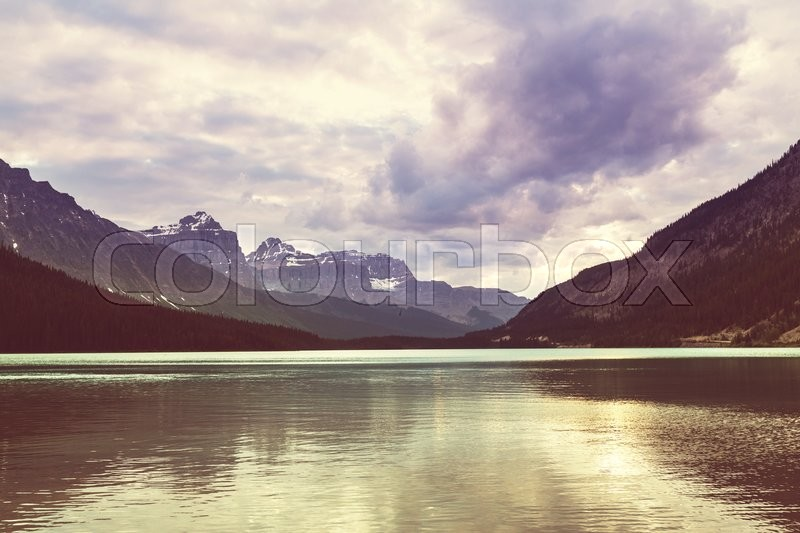 Stock image of 'Serene scene by the lake in Canada'