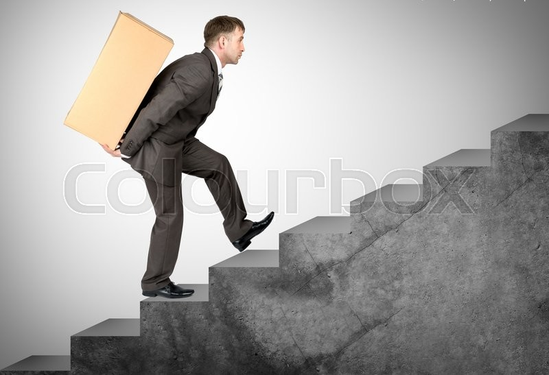 Stock image of 'Middle aged business man with difficult task going up stairs'