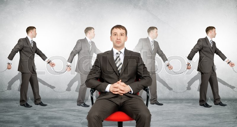 Stock image of 'Handcuffs, white collar crime, arrest. Business boss on chair'