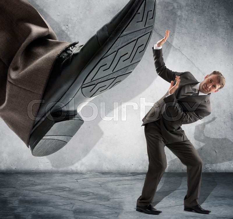 Stock image of 'Businessman foot about to stamp out competition concept for business problems, bullying or hostile take over'