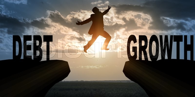 Stock image of 'Businessman with hopping over abyss from debt to growth'