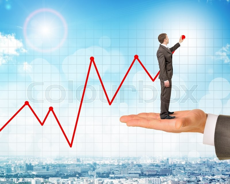 Stock image of 'Man holds businessman drawing growth chart over city background'