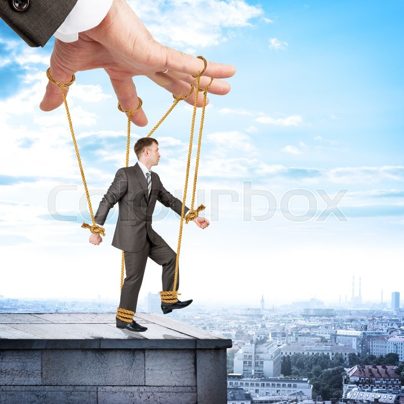 Stock image of 'Image of businessman hanging on strings like marionette. Conceptual photography'