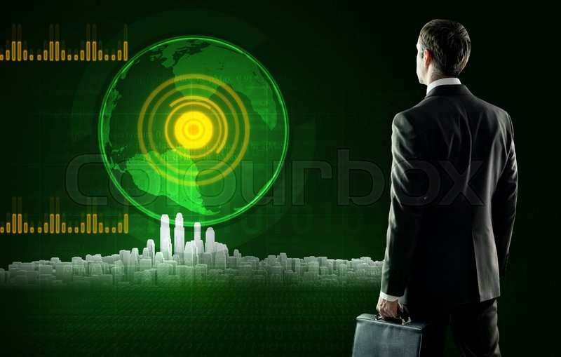 Stock image of 'Business man in suit with suitcase stands near virtual screen with city. Rear view'