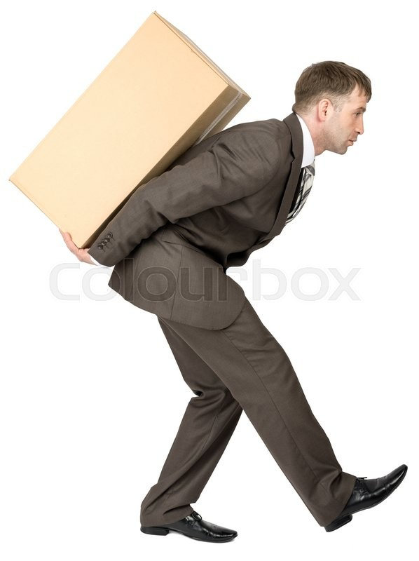 Stock image of 'Businessman holding packages on back, looks forward. Isolated on white background'
