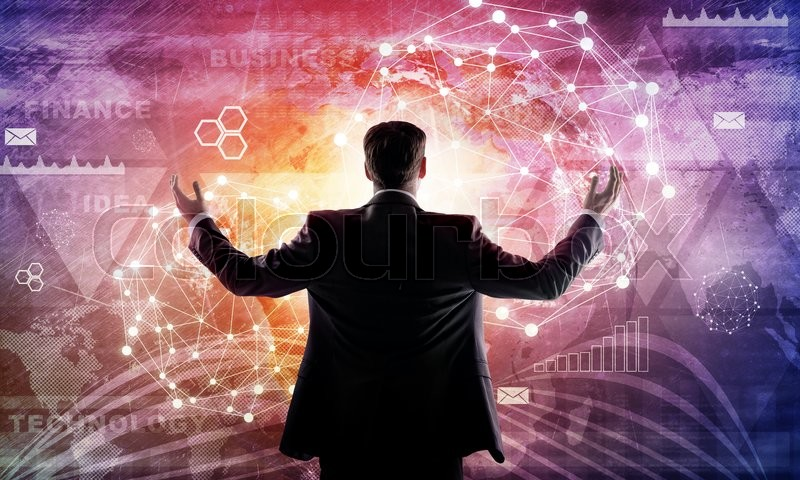 Stock image of 'Young businessman raised his hands. Media screen with icons as backdrop. Rear view. Elements of this image furnished by NASA'
