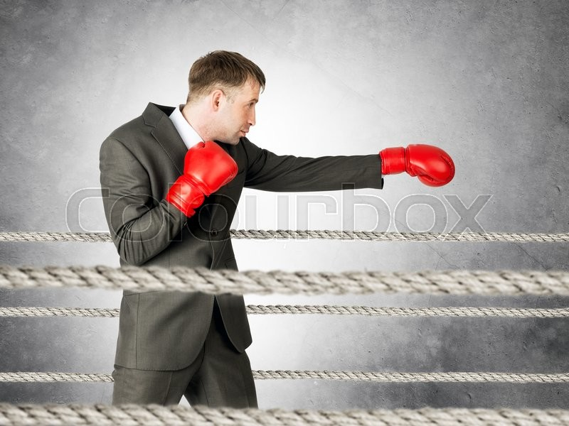 Stock image of 'Portrait of businessman boxing on boxing ring'