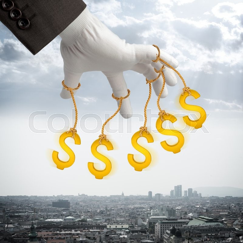 Stock image of 'Dollar signs hanging on strings like marionette. Conceptual photography'