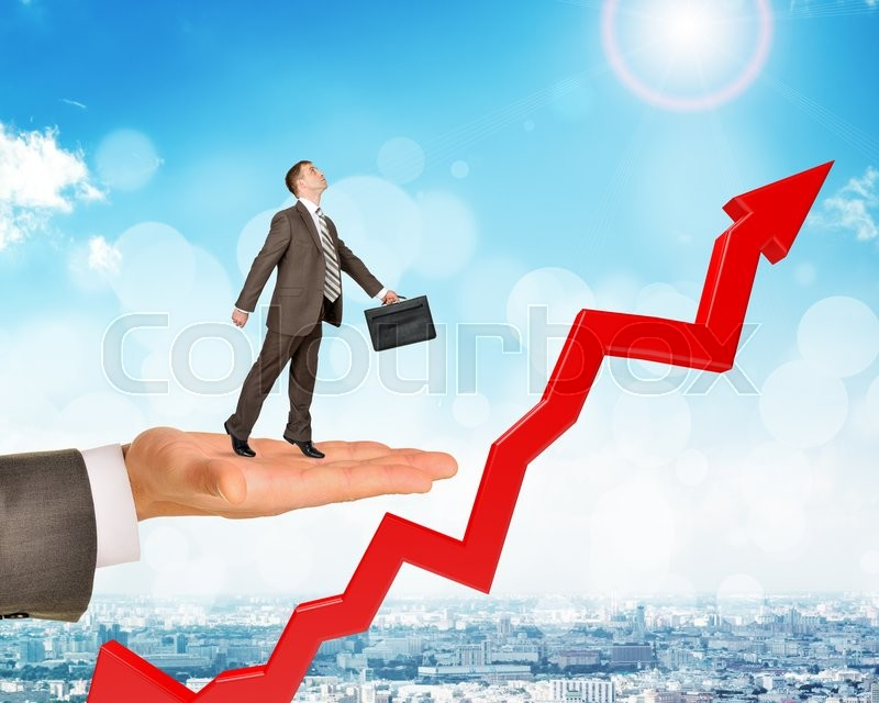 Stock image of 'Man holds businessman with growth chart  over city background'