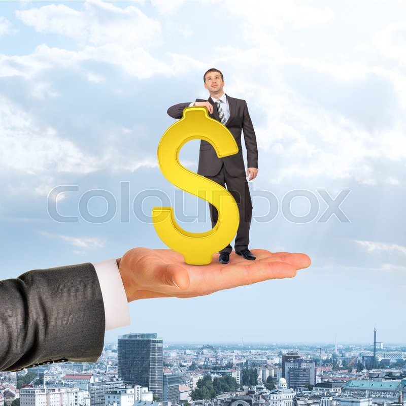 Stock image of 'Businessman with dollar sign on big hand over city background'