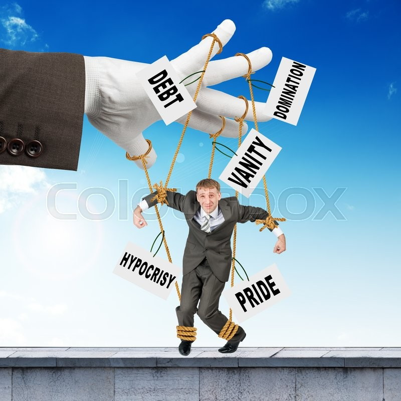 Stock image of 'Image of businessman hanging on strings like marionette with words. Conceptual photography'