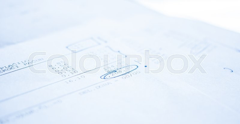 Stock image of 'number in financial report underlined by blue pen'