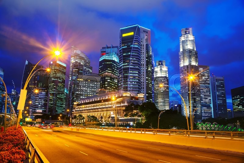 Stock image of 'Singapore financial district at the night time'