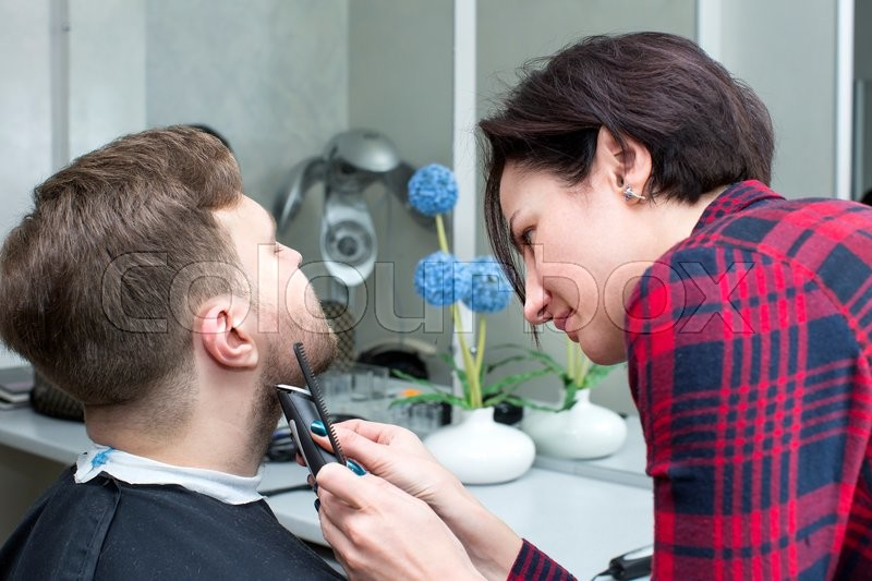 Stock image of 'The young man at the hairdresser salon hairstyle make model'