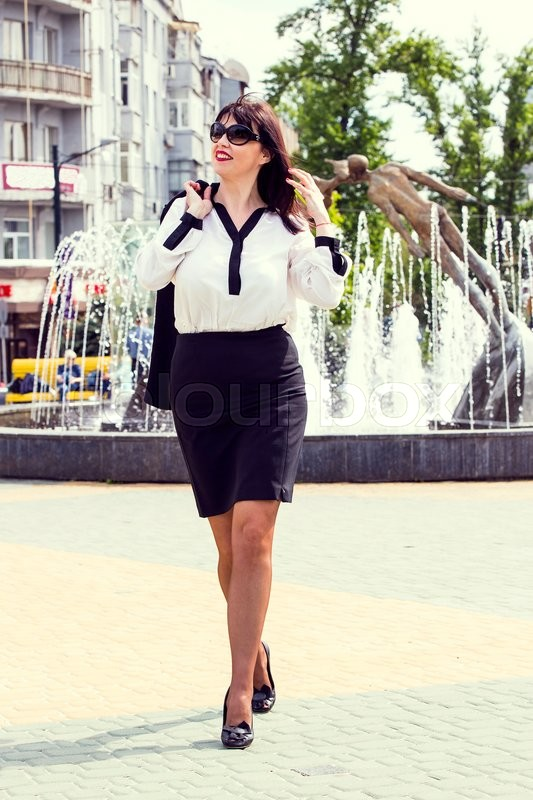 Stock image of 'Business woman walking in autumn park'