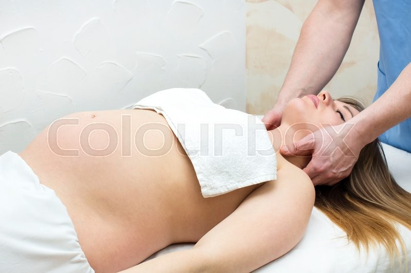 Stock image of 'Processes salon doing massage to a pregnant woman'