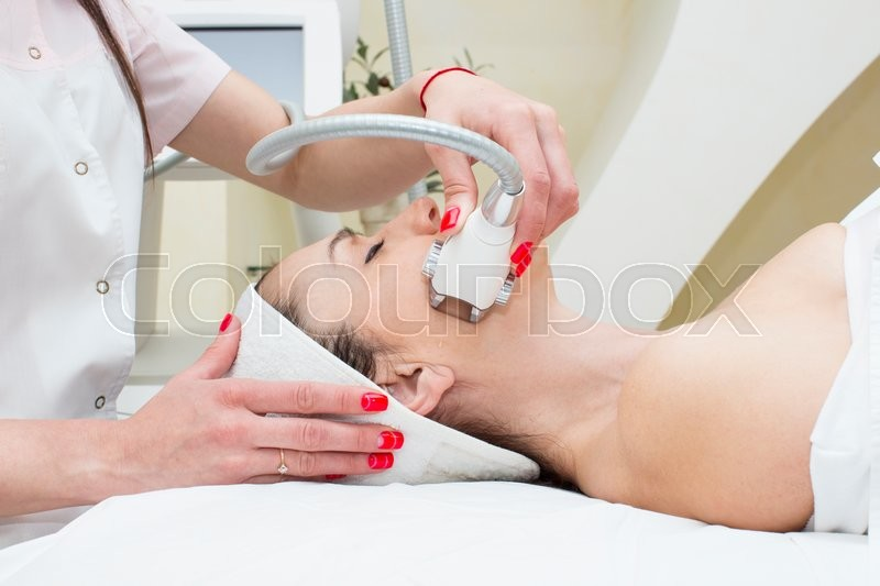 Stock image of 'Woman is in the process at the clinic lipomassage'