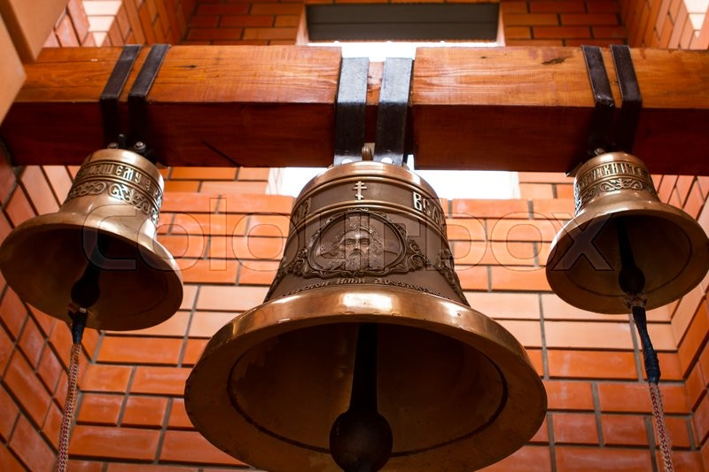 Stock image of 'Religious Christian bells. Brick bell tower. The ringing of the bell.'