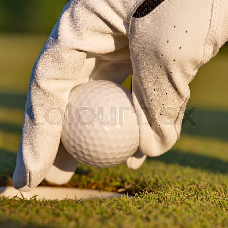Stock image of 'green field and white golf ball sport sanset'