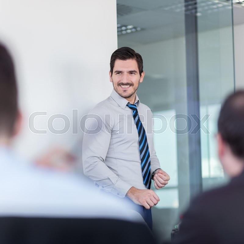 Stock image of 'Relaxed cheerful team leader and business owner leading informal in-house business meeting. Business and entrepreneurship concept.'