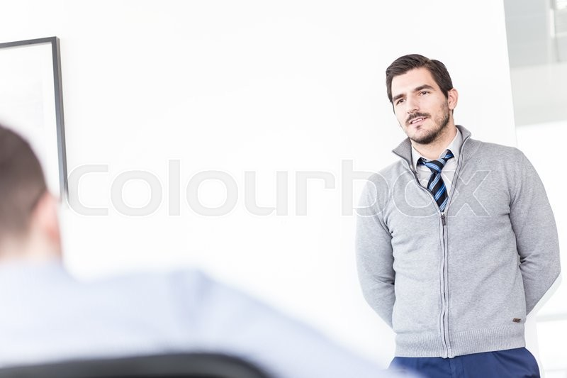 Stock image of 'Employee at the defense before the commission. Business office meeting. Business and entrepreneurship concept.'