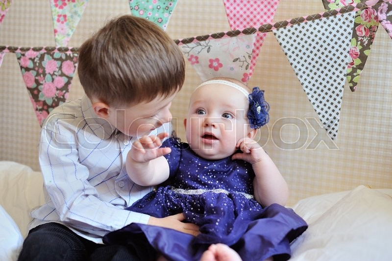 Stock image of 'Adorable little brother and sister playing together.'