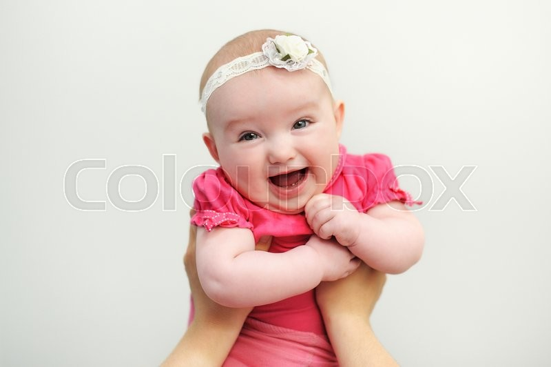 Stock image of 'Mom keeps a baby daughter in her arms.'