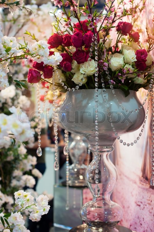 Stock image of 'Wedding decoration of flowers for ceremony in restaurant.'