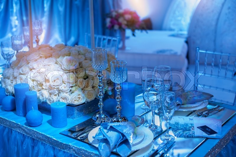 Stock image of 'Wedding decoration of flowers for ceremony in blue tones.'