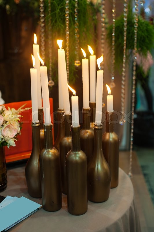 Stock image of 'decoration with candles on the table for the wedding ceremony.'