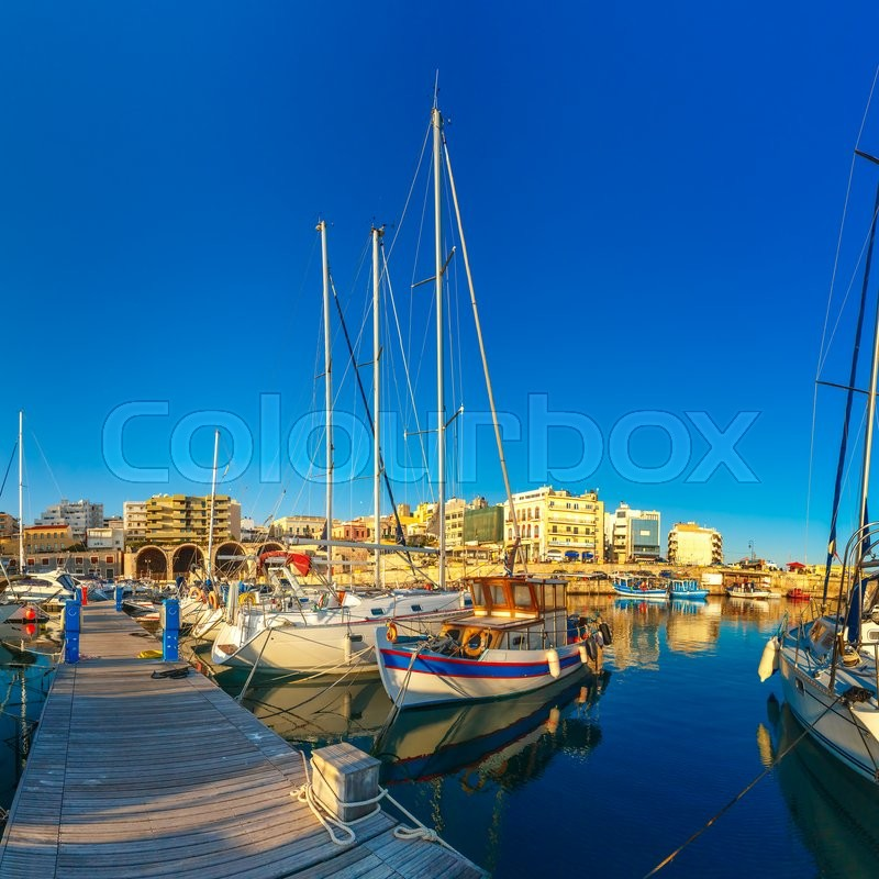 Stock image of 'Old harbour of Heraklion with fishing boats and marina in the summer sunny morning, Crete, Greece. '