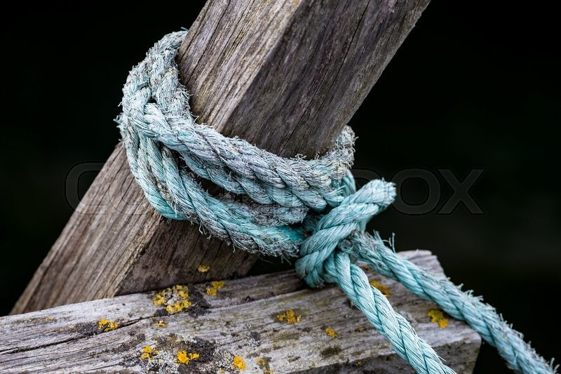 Stock image of 'Rope on a wooden pier.'