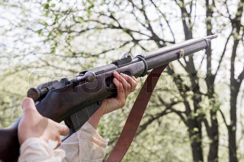 Stock image of 'Shooting a rifle with shallow depth of field'