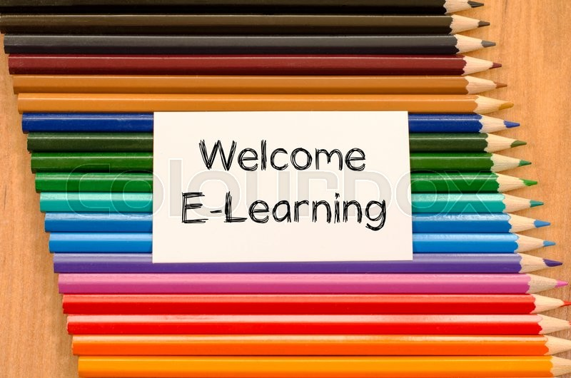 Stock image of 'Welcome e-learning text concept and colored pencil on wooden background'