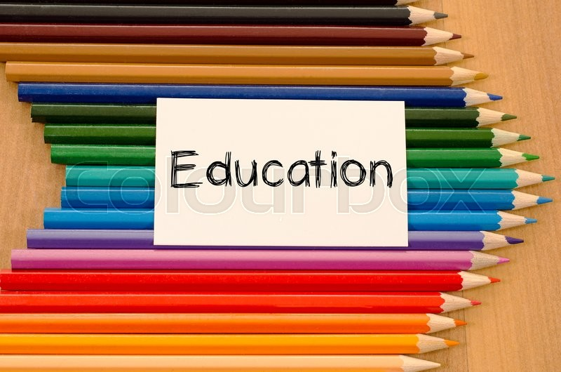 Stock image of 'Education text concept and colored pencil on wooden background'