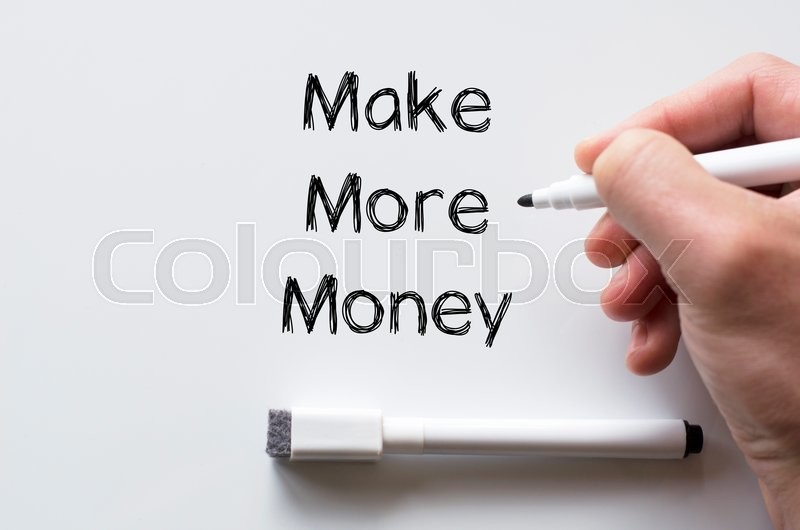 Stock image of 'Human hand writing make more money on whiteboard'