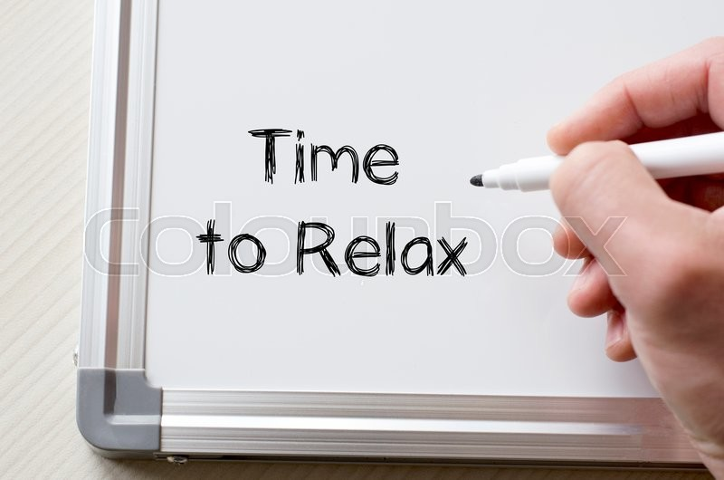 Stock image of 'Human hand writing time to relax on whiteboard'