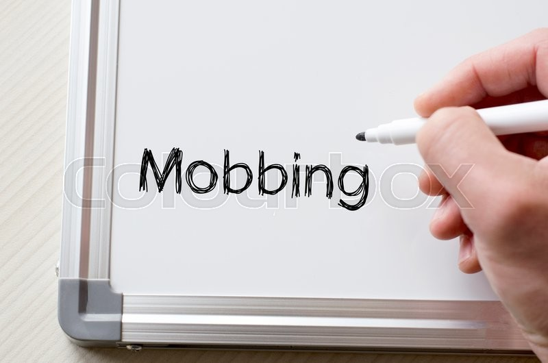 Stock image of 'Human hand writing mobbing on whiteboard'