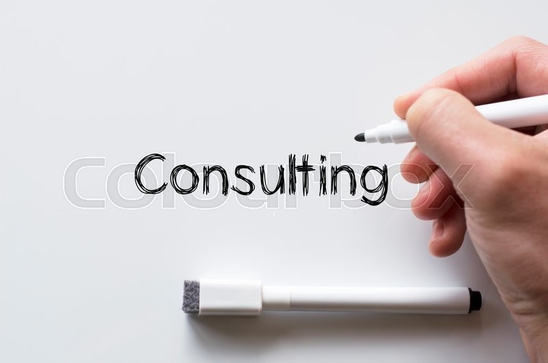 Stock image of 'Human hand writing consulting on whiteboard'