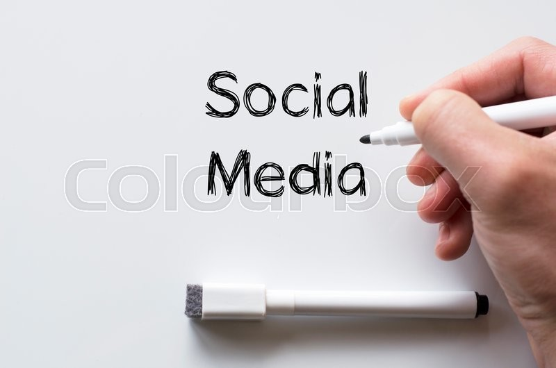 Stock image of 'Human hand writing social media on whiteboard'